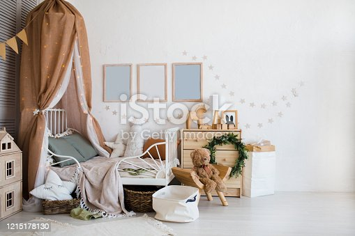 Stylish scandinavian  baby room with crib, dresser, wooden toys and lamp. zero waste. eco-friendly materials