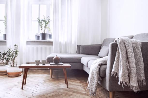 Stylish scandinavian interior of living room with small design table picture id1001153492?b=1&k=6&m=1001153492&s=612x612&w=0&h=5bw  rphro7ba6vavqua6v40augqtg2z5x97sd2b j0=