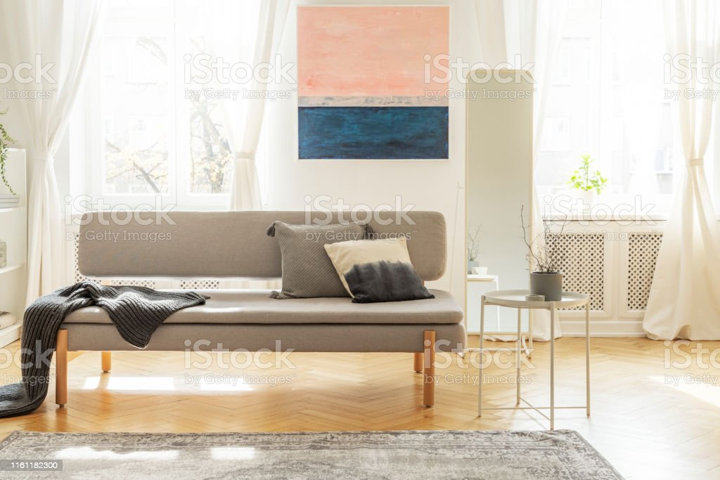 Stylish scandinavian living room interior in old tenement house