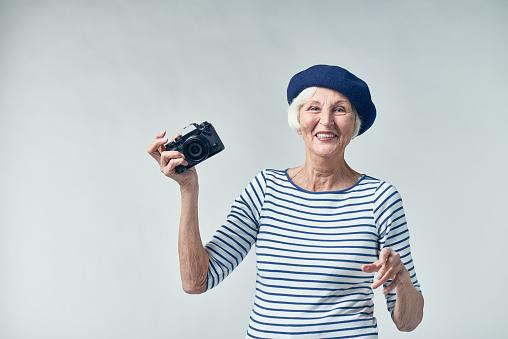 Stylish senior photographer with wide smile