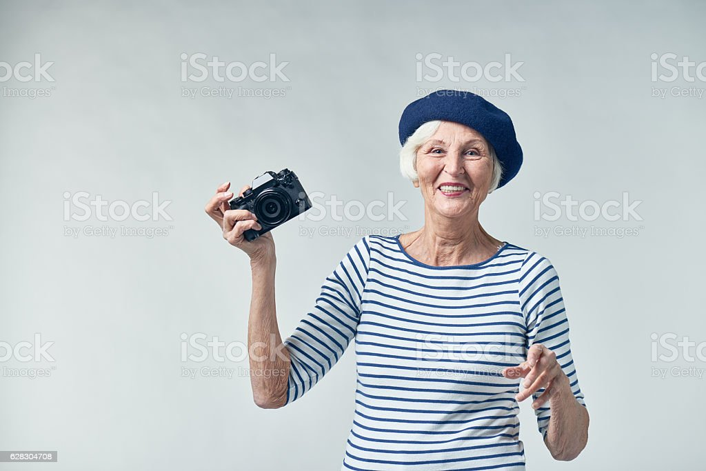 Stylish senior photographer with wide smile - Photo