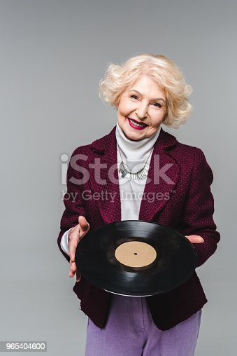 Stylish Senior Woman Holding Vinyl Disc Isolated On Gray Background - Stockowe zdjęcia i więcej obrazów Analogiczny