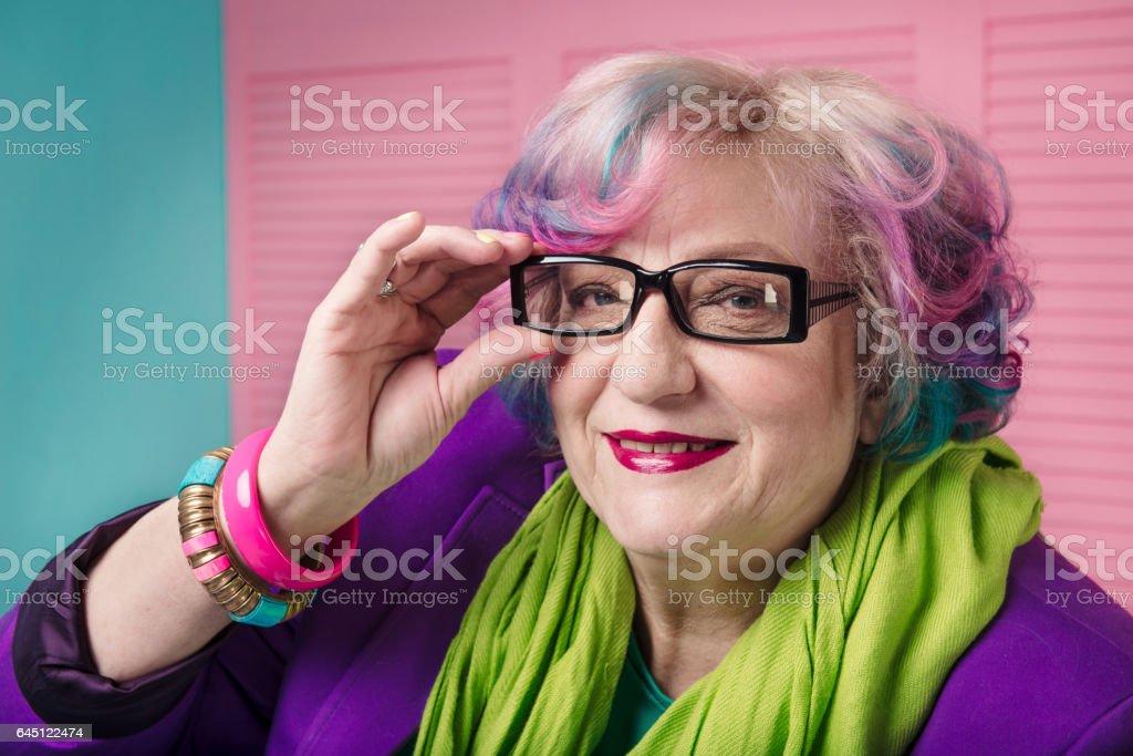 stylish senior woman wearing prescription glasses with black frame - Photo