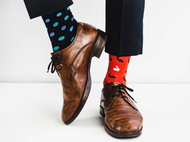 Stylish shoes and bright, funny, happy socks stock photo