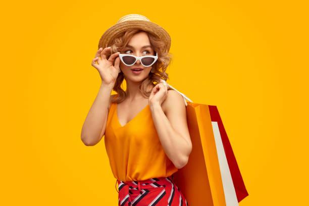 Stylish shopaholic with purchases stock photo