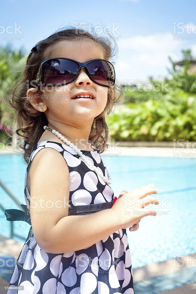 Stylish Small Cheerful Indian Girl Outdoor Portrait royalty-free stock photo