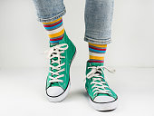 istock Stylish sneakers and funny, happy socks 943394014