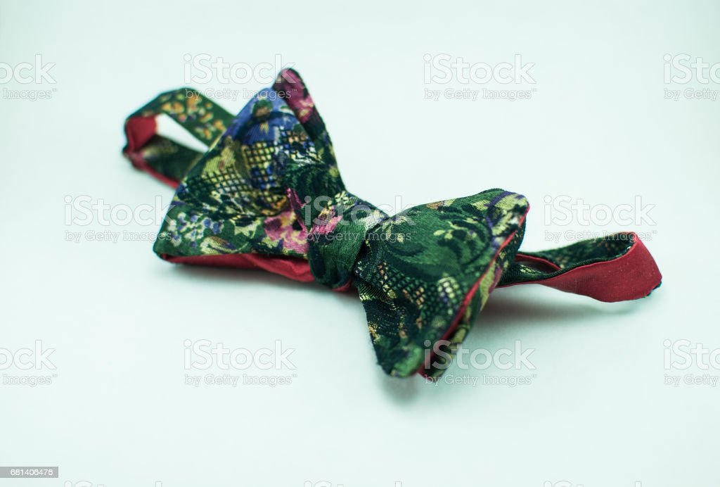 Stylish, soft, and fashionable red self tied bow tie. Isolated royalty-free stock photo