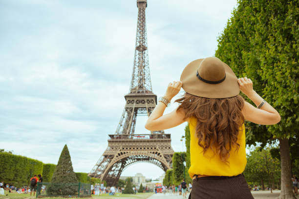 stylish solo tourist woman in Paris, France sightseeing stock photo