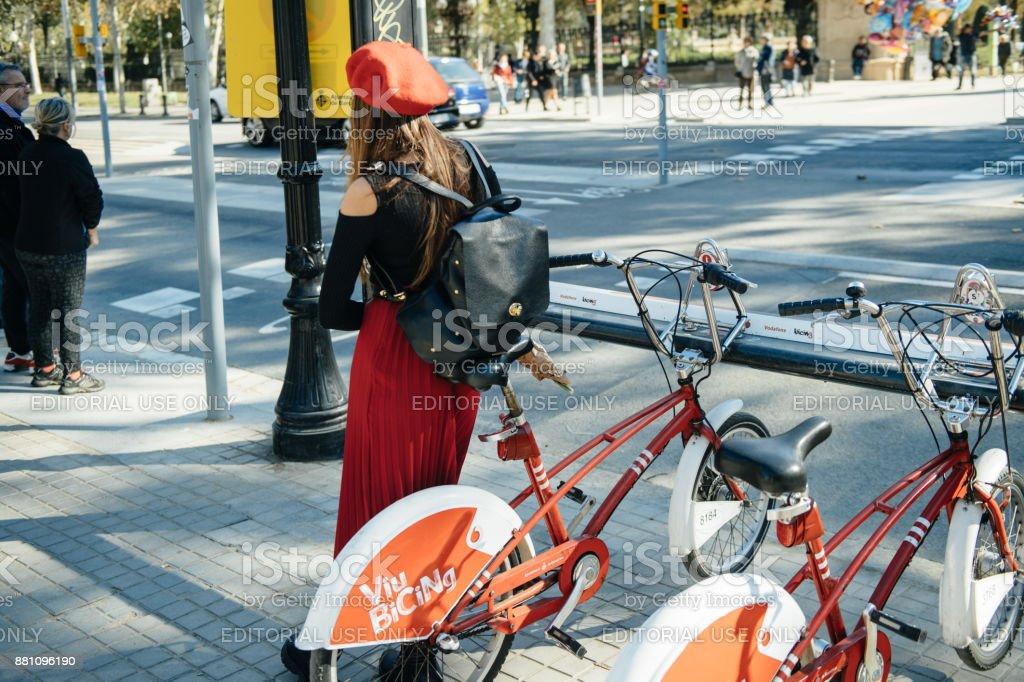 Stylish Spanish woman wearing red beret date stock photo
