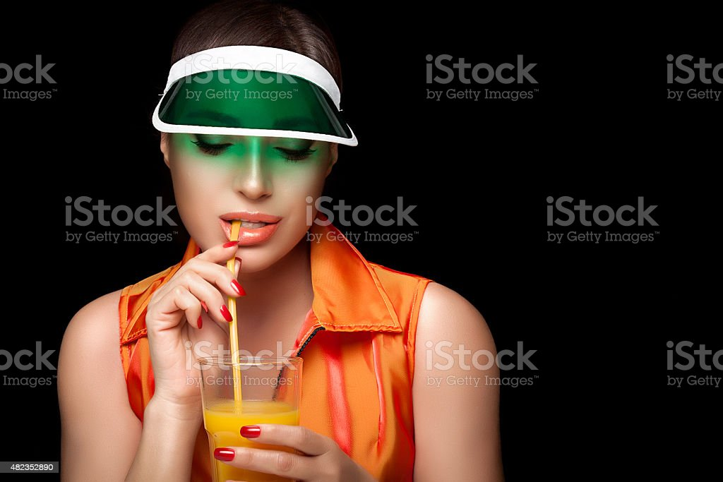 Stylish Sporty Woman Sipping a Glass of Juice. Beauty Dieting stock photo