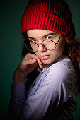 istock stylish street girl in shirt and red cap posing to the camera 1127487829