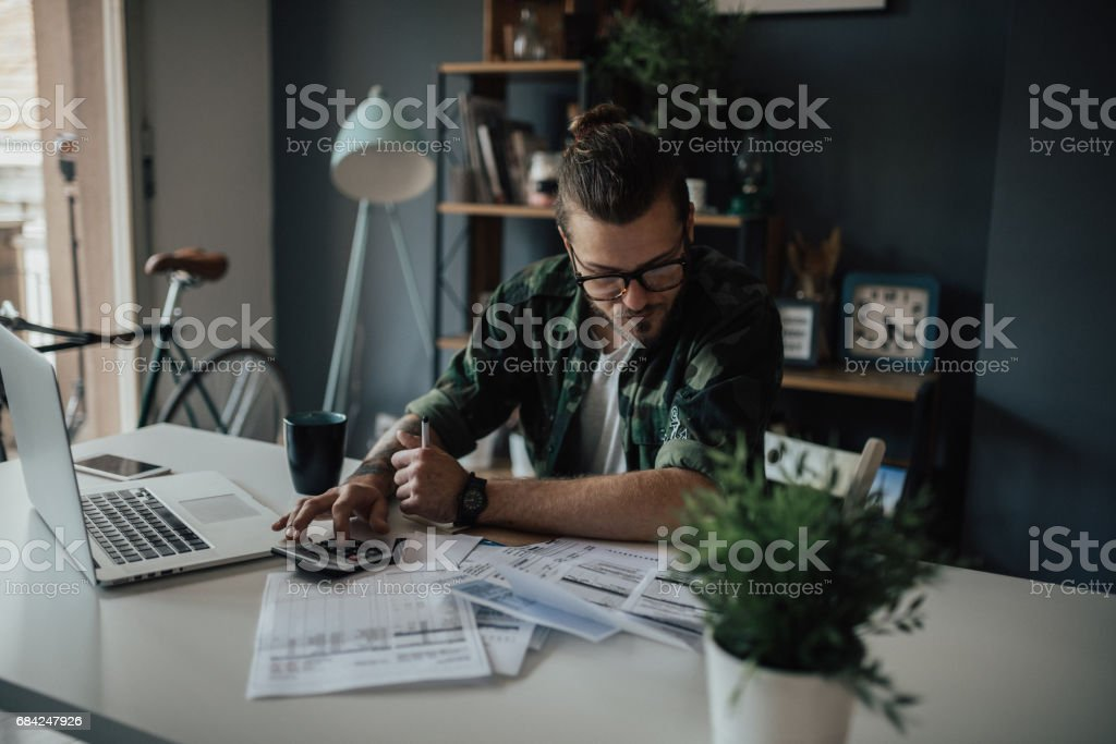 Stylish student is concerned about overdue bills royalty-free stock photo