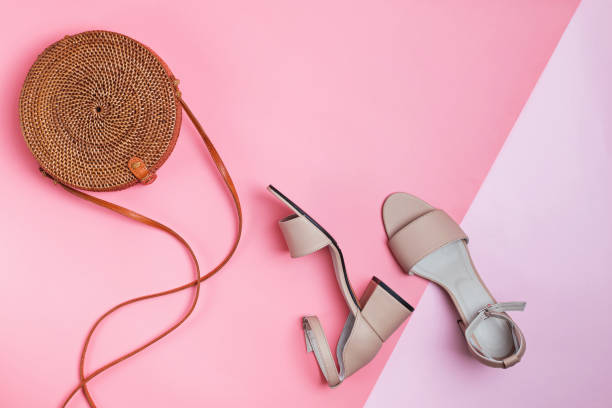 Stylish summer accessories isolated on pink background. stock photo