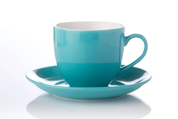 stylish teal color cup and saucer - theekop stockfoto's en -beelden