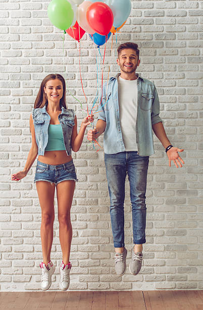 stylish teenage couple - jean shorts stock photos and pictures