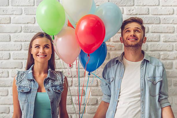 stylish teenage couple - ballonhose stock-fotos und bilder