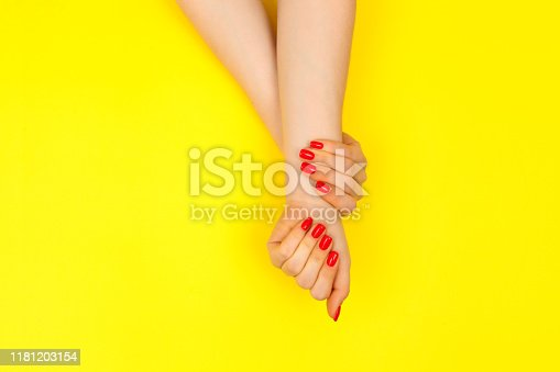 1128559926 istock photo Stylish trendy red female manicure. Flat lay 1181203154