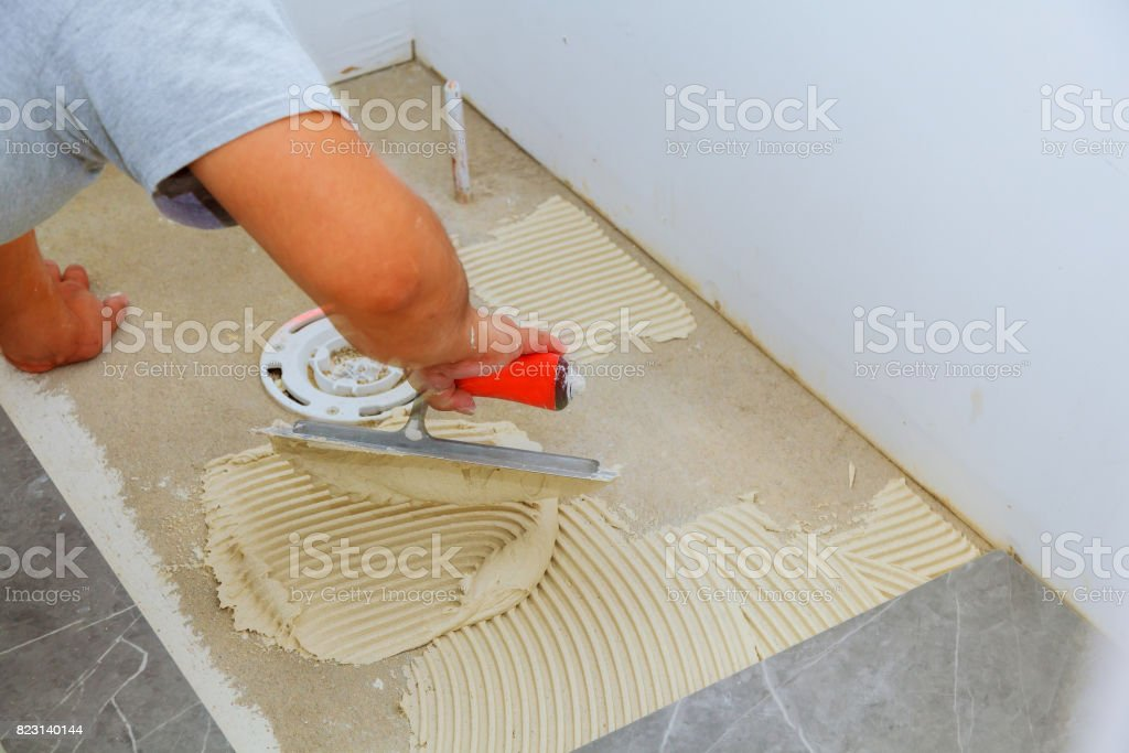 Stylish trendy white ceramic tile with a chamfer on the Repair of apartments and bathrooms. stock photo
