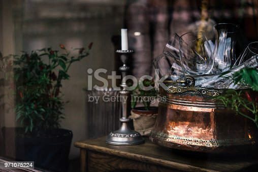 istock stylish vintage bowl with glasses and candle in a window, celebration decoration for holidays in the city 971075224