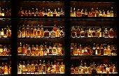 istock Stylish wall full of spirit bottles in a bar 1265468202