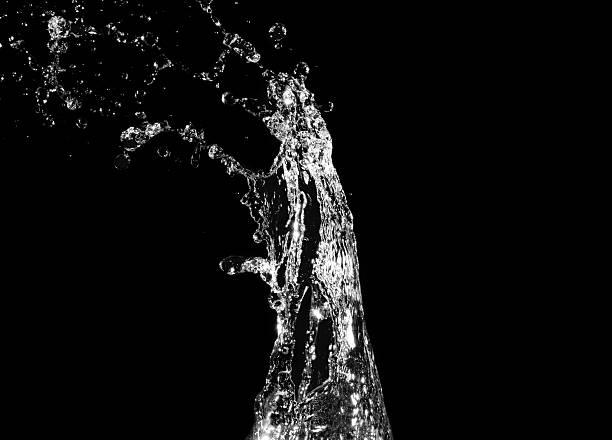 Stylish water splash. Isolated on black background stock photo