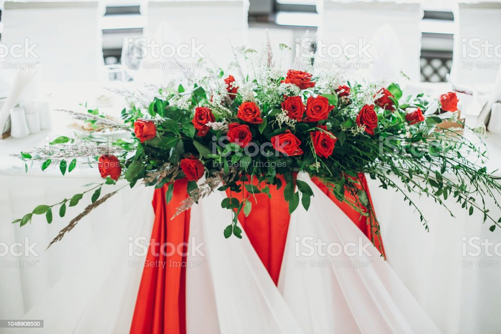 Stylish Wedding Table Setting Centerpiece Elegant Wedding Table With Red Roses Decoration And White Silk Chairs And Napkins Luxury Catering In