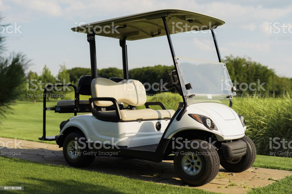 Stylish white golf cart stock photo