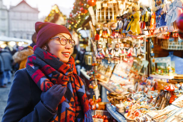 Stylish woman buys gifts and souvenirs at the Christmas market in Prague Stylish woman buys gifts and souvenirs at the Christmas market in Prague czech culture stock pictures, royalty-free photos & images