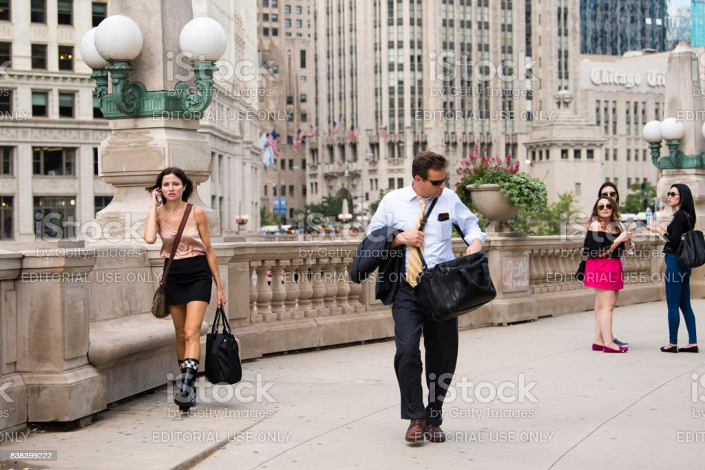Stylish woman commutes home downtown Chicago stock photo