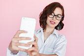 istock Stylish woman in studio taking selfie 868474774