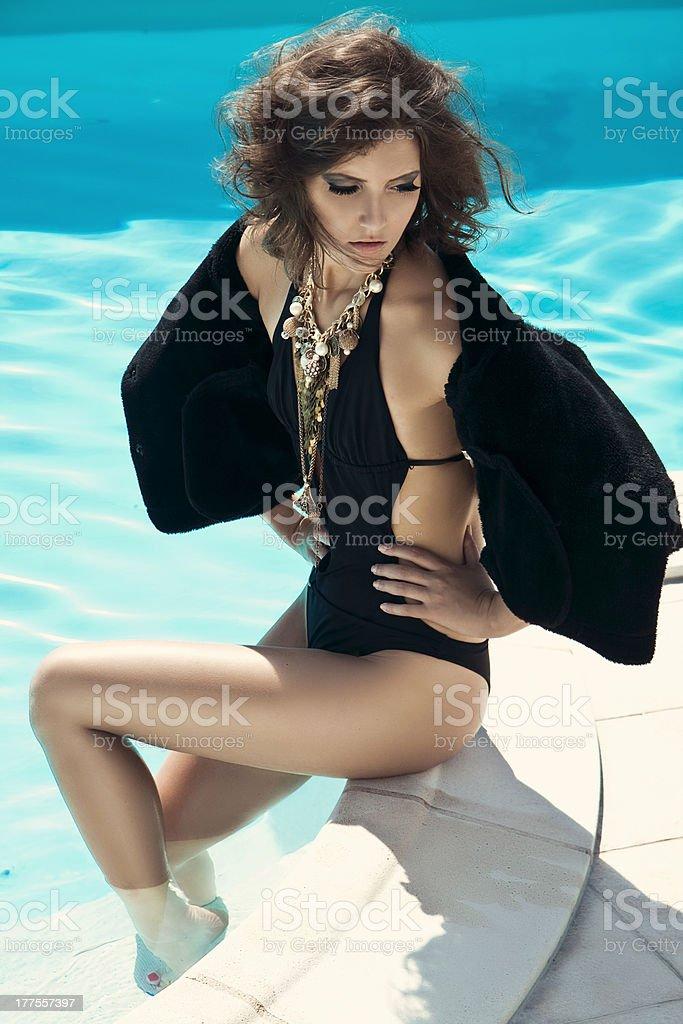 stylish woman in the swimming pool stock photo