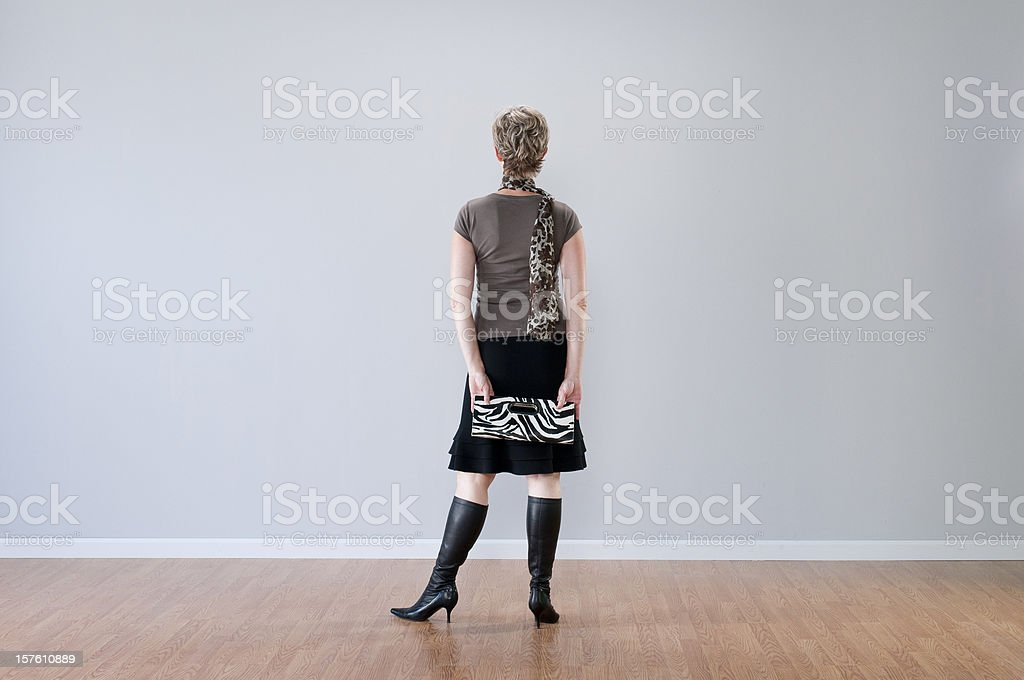 Stylish Woman Looking At Blank Wall