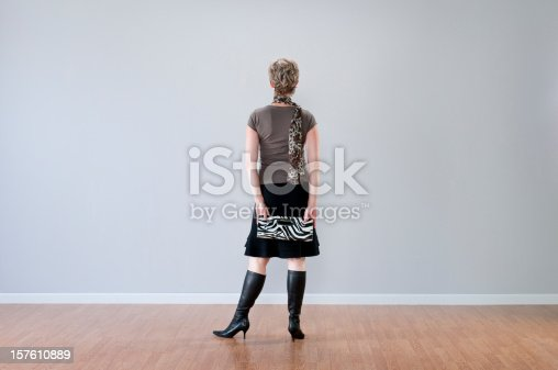istock Stylish Woman Looking At Blank Wall 157610889