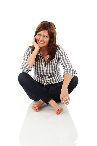 stylish woman sitting relaxed - sitting on floor stock photos and pictures