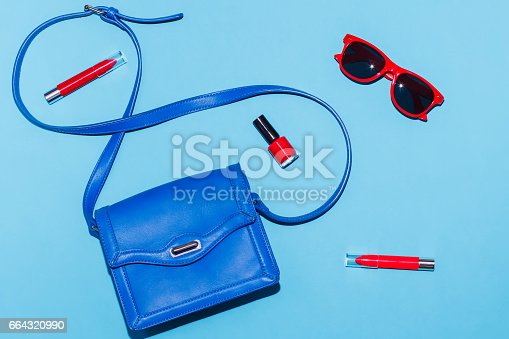 istock Stylish woman summer accessories in red and blue colors 664320990