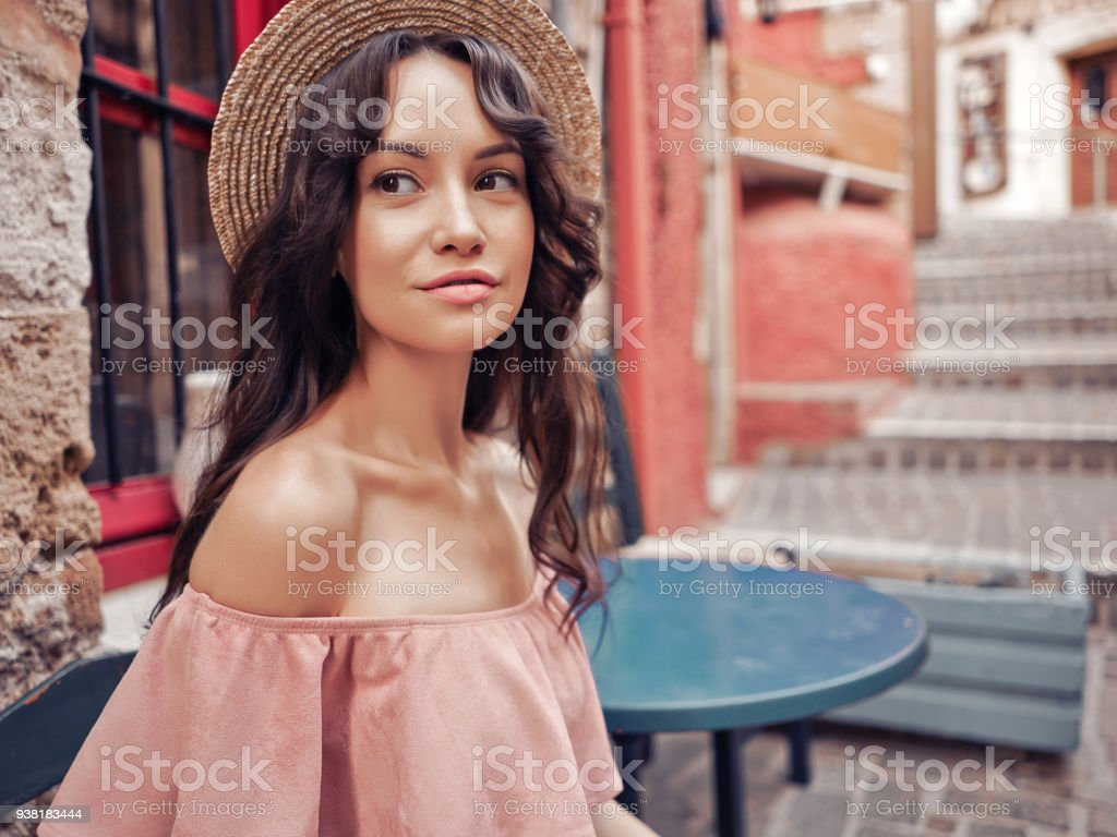 Stylish woman walking in old town stock photo