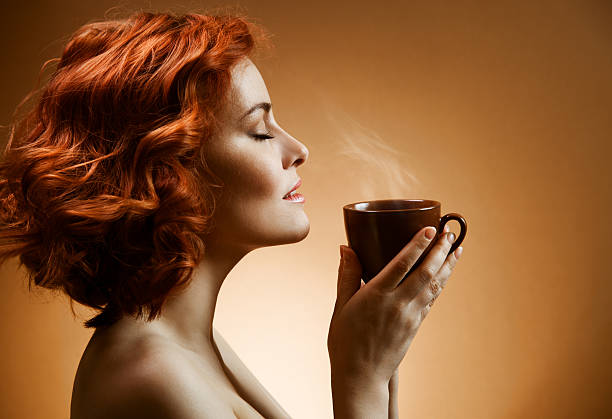 Stylish woman with an aromatic coffee in hands stock photo