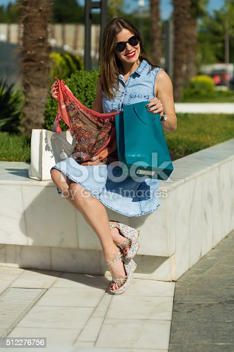 615594632 istock photo Stylish woman with shopping bags 512276756