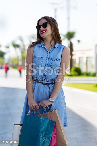 615594632 istock photo Stylish woman with shopping bags 515078940