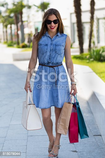 615594632 istock photo Stylish woman with shopping bags 515079044