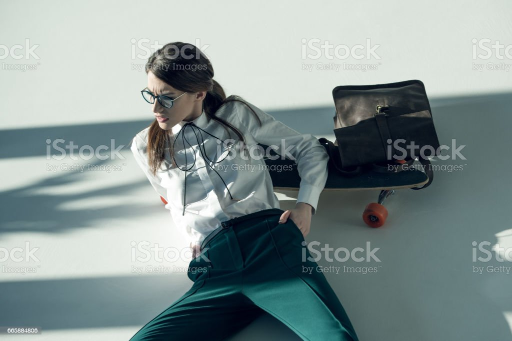 stylish woman with skateboard stock photo