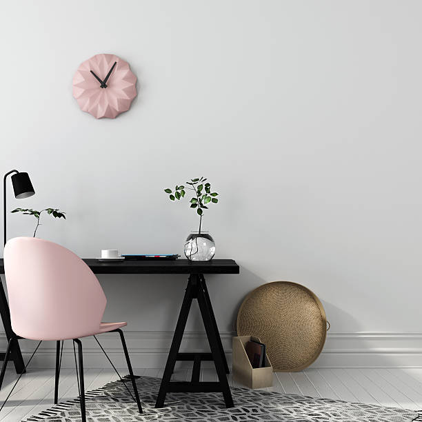 Stylish workplace with a pink chair