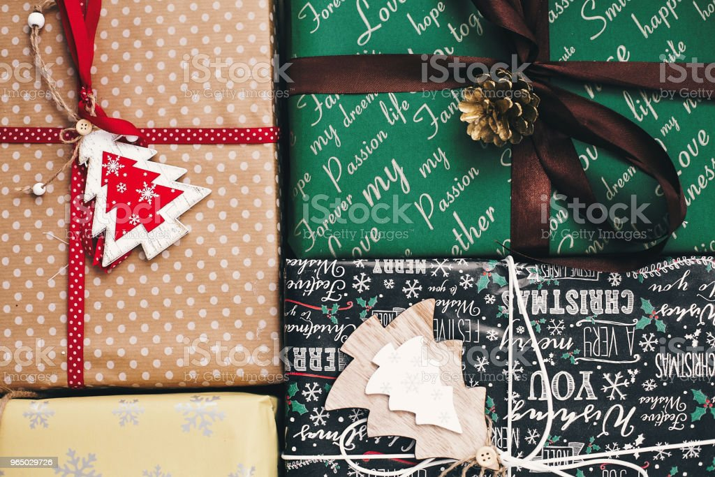 stylish wrapped gift boxes top view, with ornaments tree pine cones and twine. merry christmas and happy new year concept. image flat lay. seasonal greetings, happy holidays royalty-free stock photo