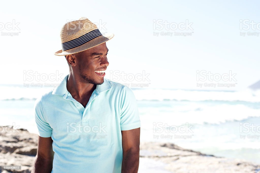 Stylish young african man at the beach stock photo