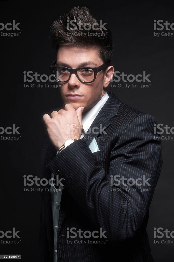 92e970662993 Stylish young business man wearing retro black glasses. - Stock image .