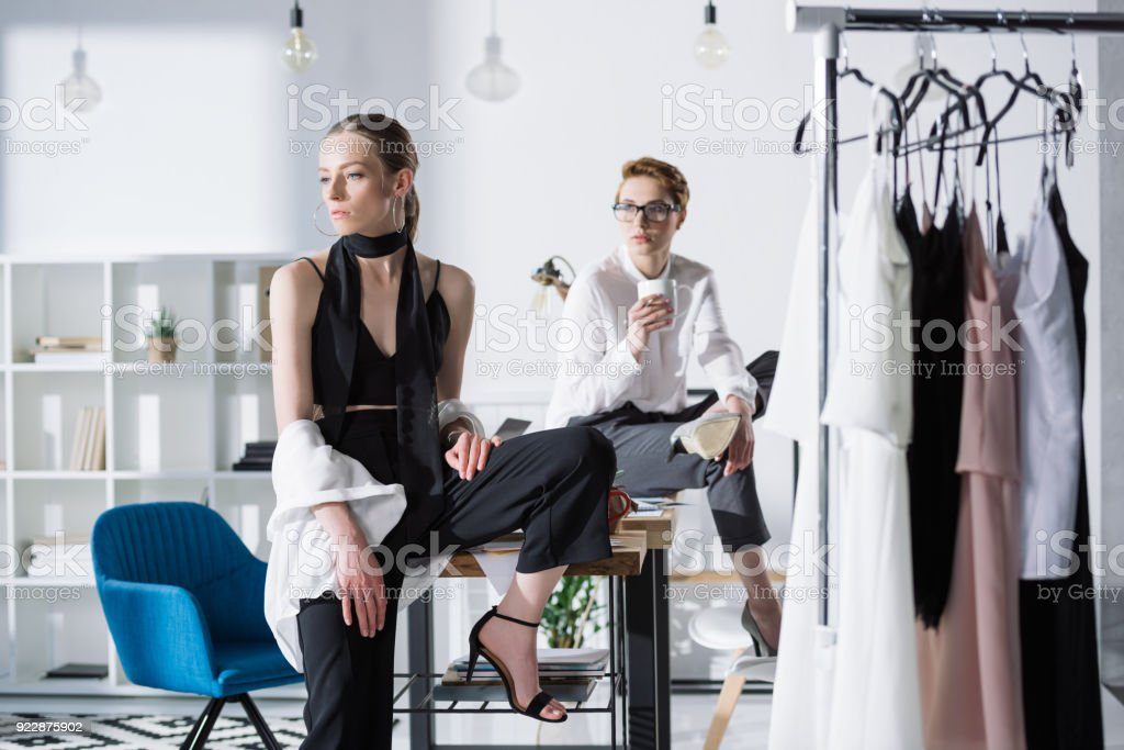 Stylish Young Fashion Designers Sitting On Work Desk At Office Stock Photo Download Image Now Istock