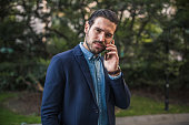 Stylish young man is talking on mobile phone
