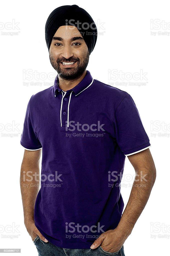 Stylish young man looking at camera stock photo