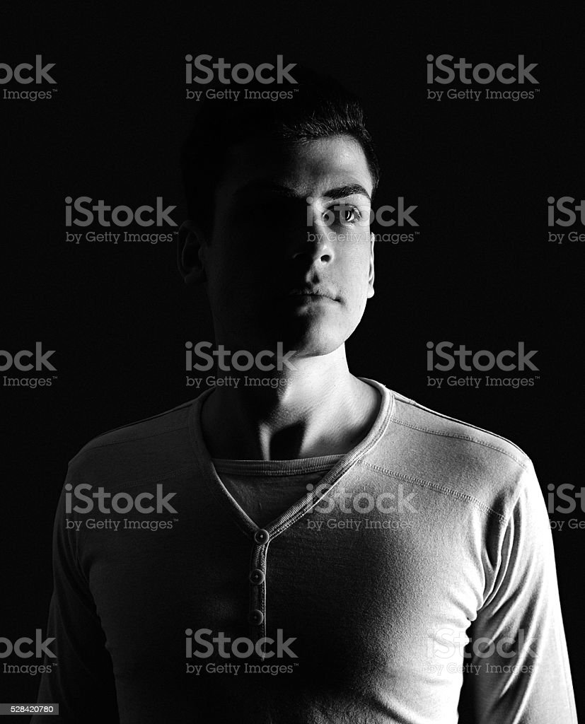 stylish young man portrait in low-key - Royalty-free Achtergrond - Thema Stockfoto